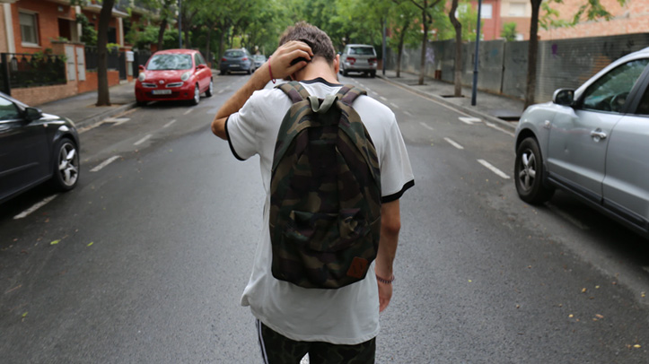 Teenager walking with backpack