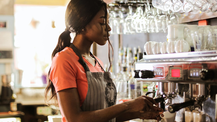 Young woman working as a barista