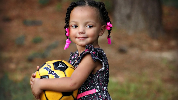 Girl holding football